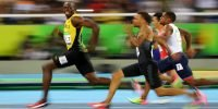 Bolt reaches men's 200m final