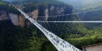 China's spectacular glass-bottomed bridge closes weeks after opening