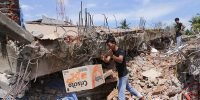Earthquake kills nearly 100 in Indonesia