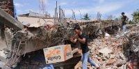 Earthquake kills nearly 100 in Indonesia