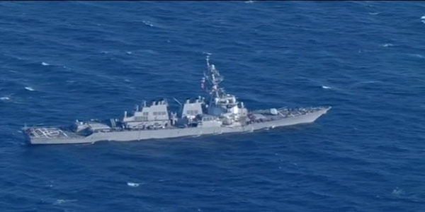 Seven missing after US Navy ship collides with merchant vessel