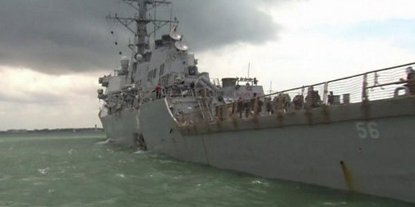 US destroyer collides with oil tanker, 10 missing