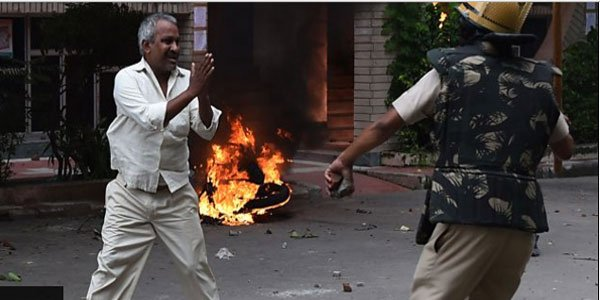 Violence after godman's conviction leaves 29 killed in India