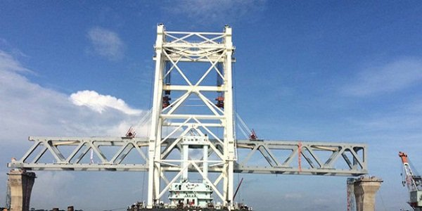 Installation of span gives partial view of Padma Bridge