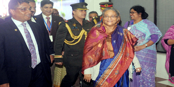 Hasina returns home