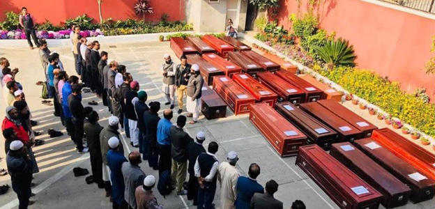 Relatives receive coffins in tears