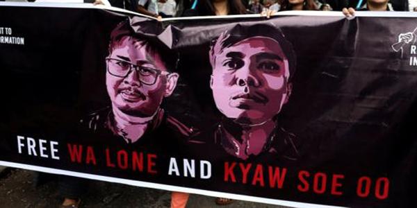 Myanmar jails two Reuters journalists over secret papers