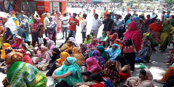 Garment workers block roads in Mirpur to demand payment of wages